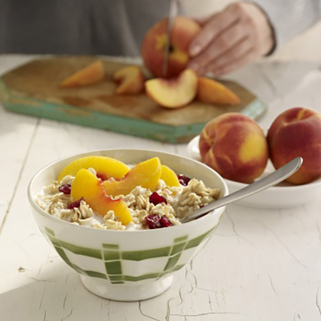 gluten free porridge with sliced apricot and cranberries in a bowl