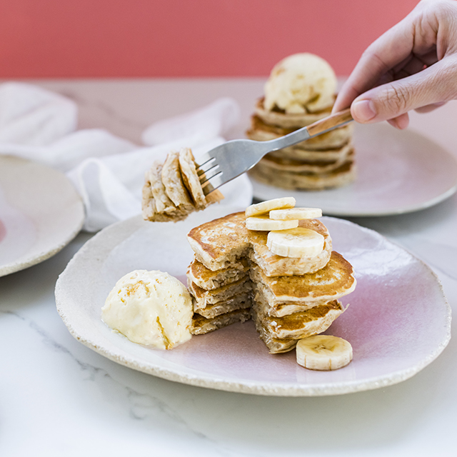 Oat pancakes topped with banana and syrup