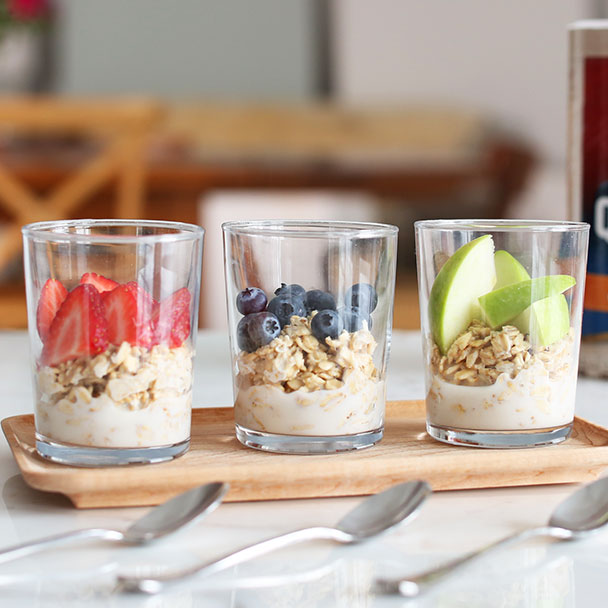 overnight oats 3 ways with sliced strawberries, blueberries, or apples